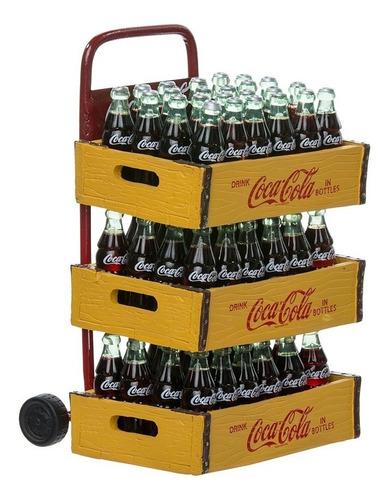 santa claus con cajas de coca cola y carretilla de carga
