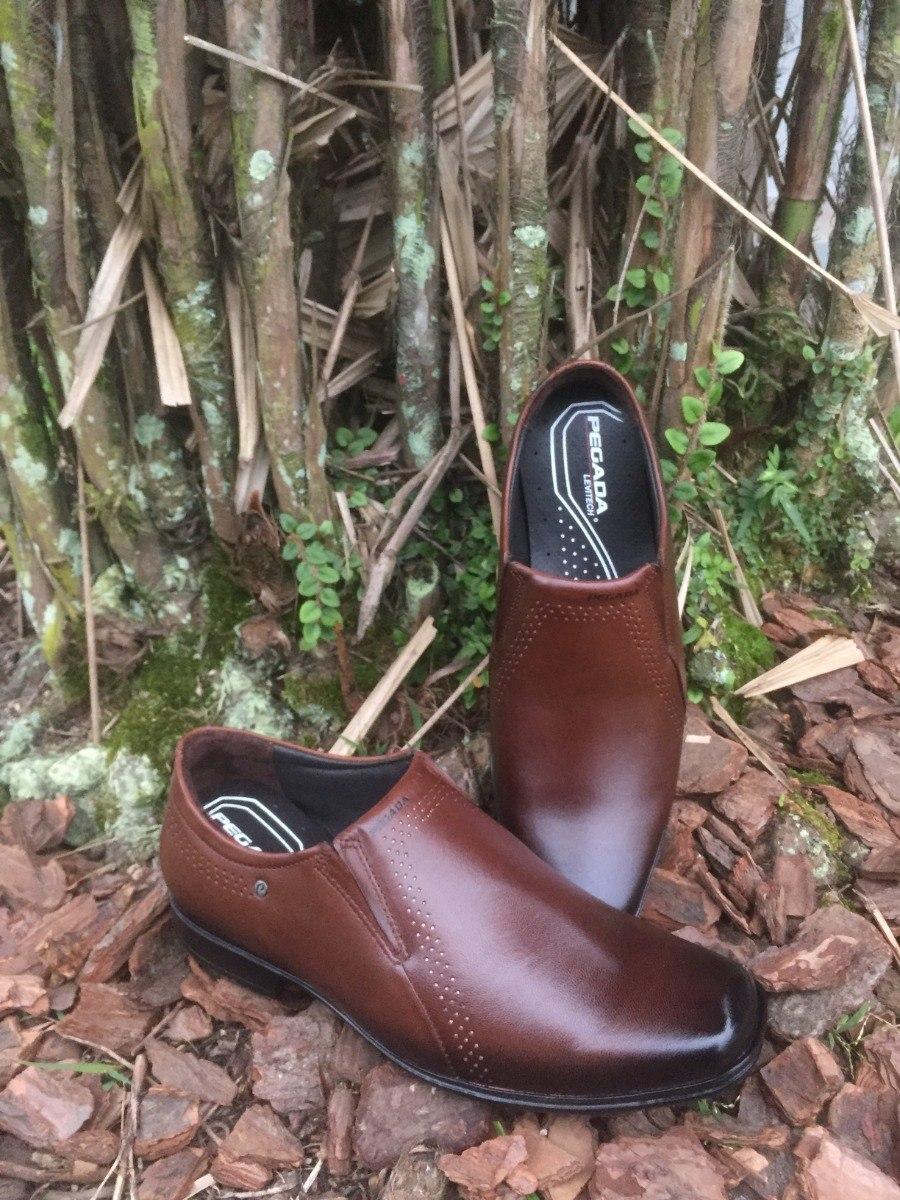 3ad2a4633f sapato masculino em couro pegada pinhão. Carregando zoom.