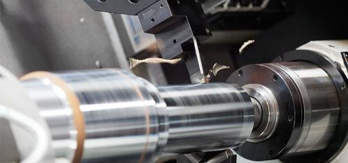 se hacen ejes, probetas y piezas de acero, aluminio