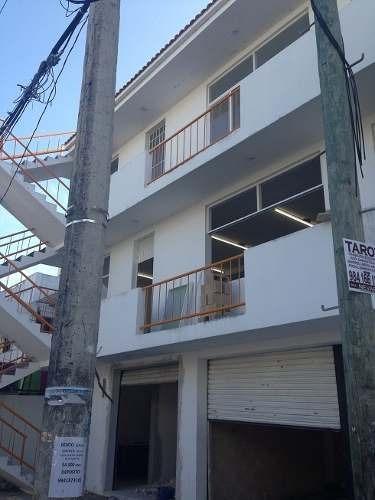 se vende edificio sobre avenida transitada localizado en el centro de playa del carmen p1475