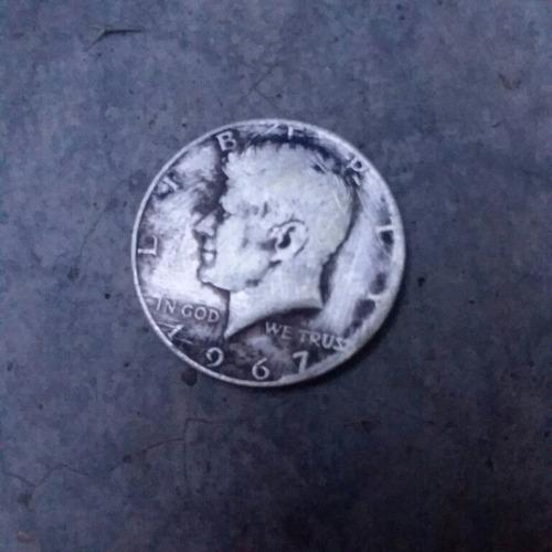 se vende moneda de plata de half dollar 1967