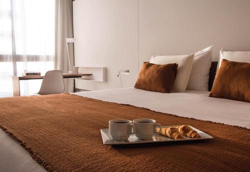 sea dueño de una habitación en un hotel y participe de la rentabilidad del negocio hotelero.