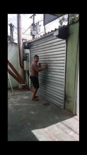 serviço de serralheria portão, porta de loja e etc...