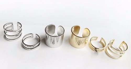 set de anillos de metal cromados y bolsa de regalo