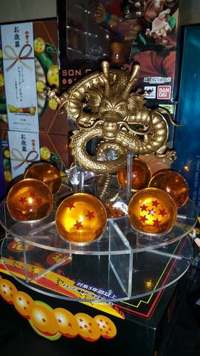 shen long  golden y clasico con base y esferas en caja .