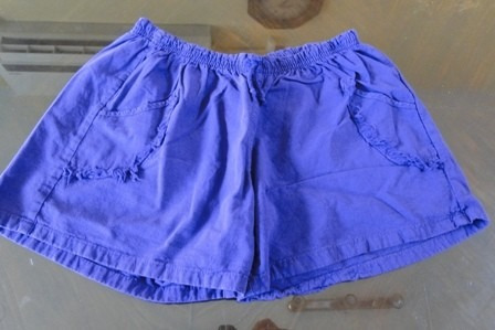 short de algodon. talle m. color violeta con bolsillos