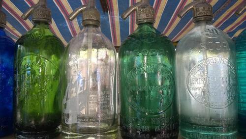 sifones antiguos de colores cabeza de plomo y relieve
