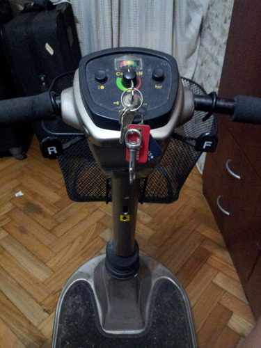 silla de rueda a bateria electrica, scooter