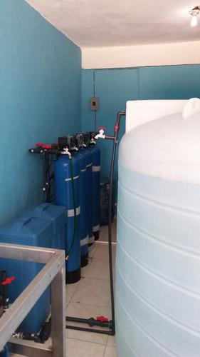 sistema de tratamiento de agua con llenadoras y lavadoras