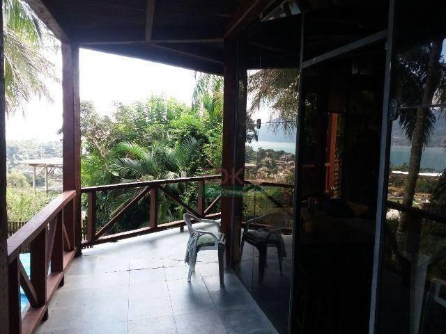 sobrado com 2 dormitórios à venda, 133 m² por r$ 731.400 - itaguaçú - ilhabela/sp - so0979