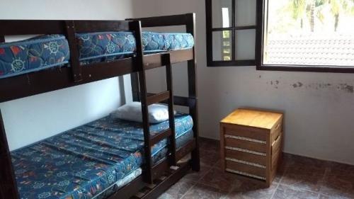 sobrado com 2 quartos, frente mar, aceita parcelar!