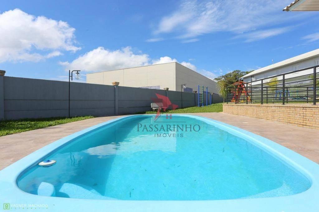 sobrado com 3 dormitórios à venda, 78 m² por r$ 245.000 - centenário - torres/rs - so0154