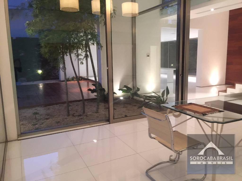 sobrado com 4 dormitórios à venda, 520 m² por r$ 3.000.000 - condomínio sunset - sorocaba-sp, próximo ao shopping iguatemi. - so0139