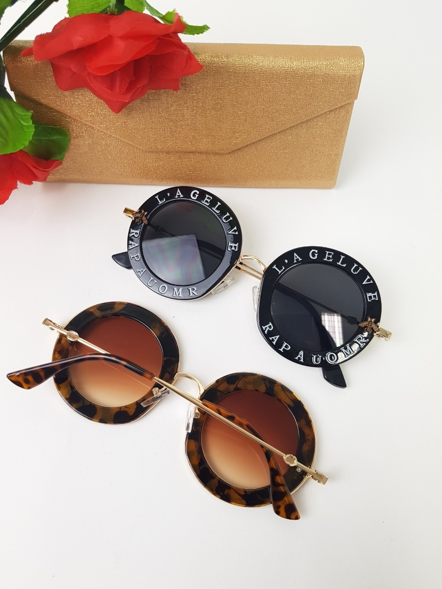 Óculos De Sol Gucci Redondo Escrita Na Armação Proteção Uv - R  159 ... 9ecf36718d