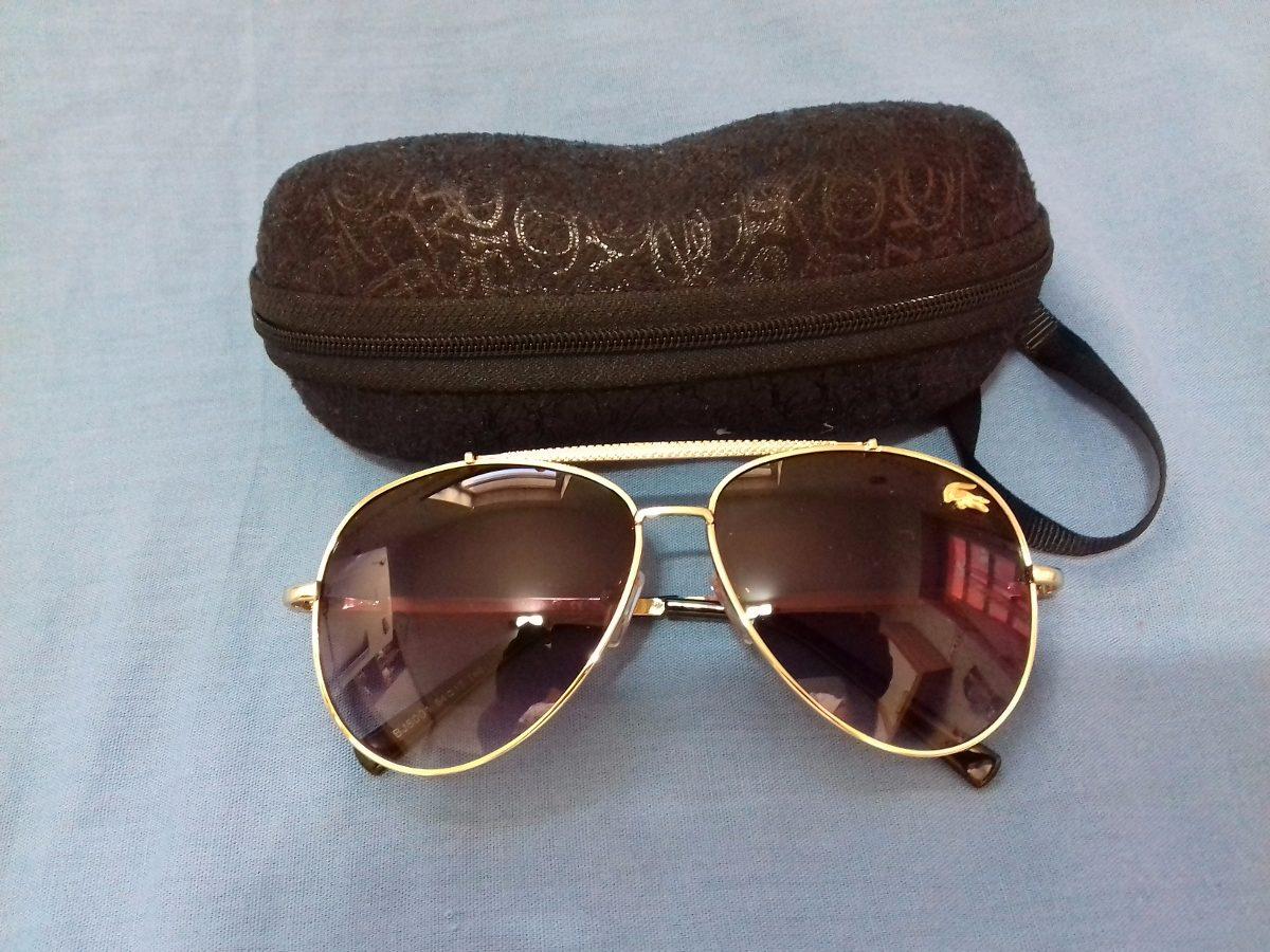 878f6248f8c4c Óculos De Sol Lacoste Dourado - Novo - R  249