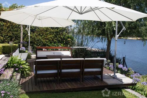 sólida y acogedora casa a la laguna central, en venta o alquiler