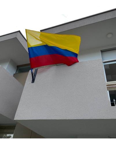 soporte y bandera de colombia - unidad a $94900