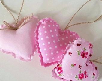 souvenirs colgante corazòn de tela (xunidad)