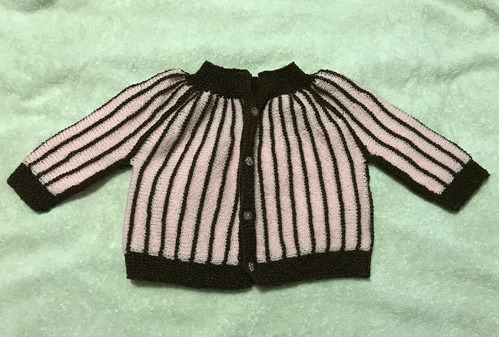 suéter para bebe de 6 a 9 meses tejido a mano en dos agujas