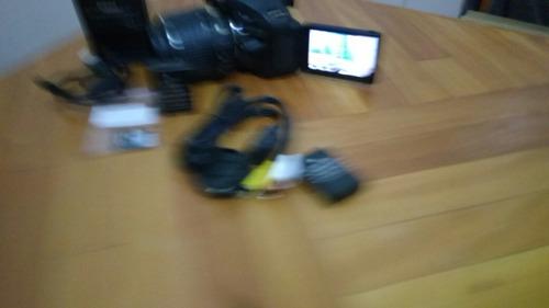 super camera nikon d5200 com  3 baterias de brinde