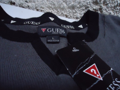 sweater guess gris talla l $590.00
