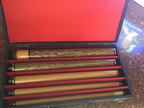 taco de billar en madera tallada