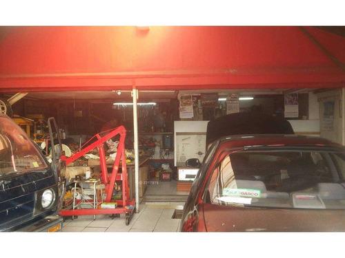 taller mecánico funcionando. con casa habitación.