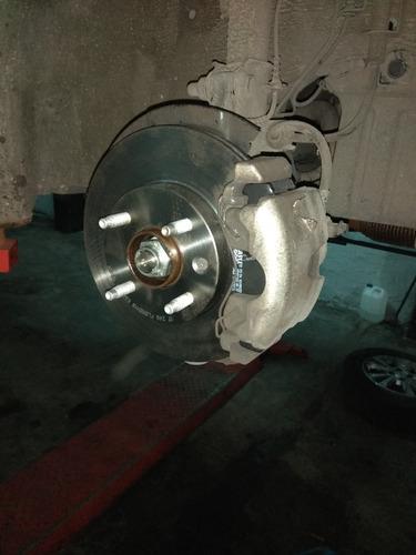 taller mecánico tren delantero suspensión freno distribución