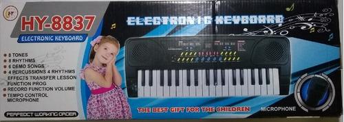 teclado musical / graba/ micrófono / tonos envío gratis