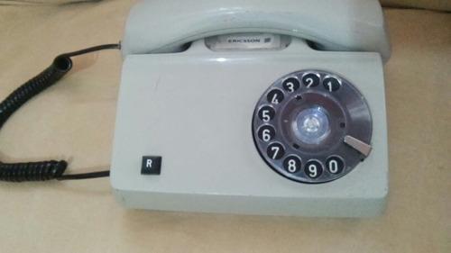 teléfono ericsson de disco decorativo