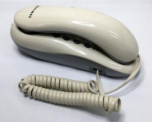 telefono fijo color beige marca orientel modelo kx-t333
