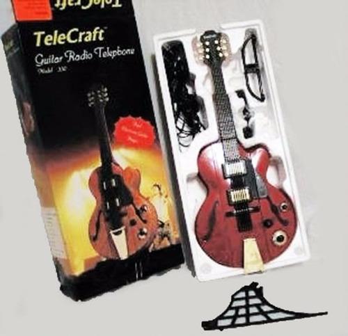 telefono guitarra radio fm y am