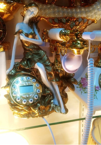 teléfono vintage s. xix con estatua