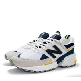 92c43bf096e Tenis New Balance 574 Branco Azul E Amarelo Original