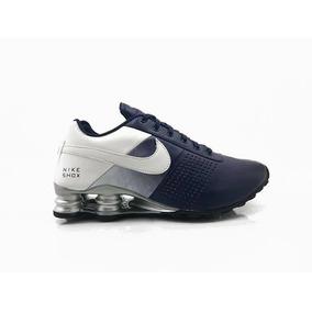 b9e1bac5a18 Tenis Oakley Caveirão Camuflado Nike Shox - Para Tênis Azul marinho ...