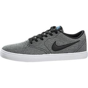 busca lo mejor bastante baratas venta oficial Nike Men 's Sb Check Solar Lona Zapatillas, Negro, 10 D(m