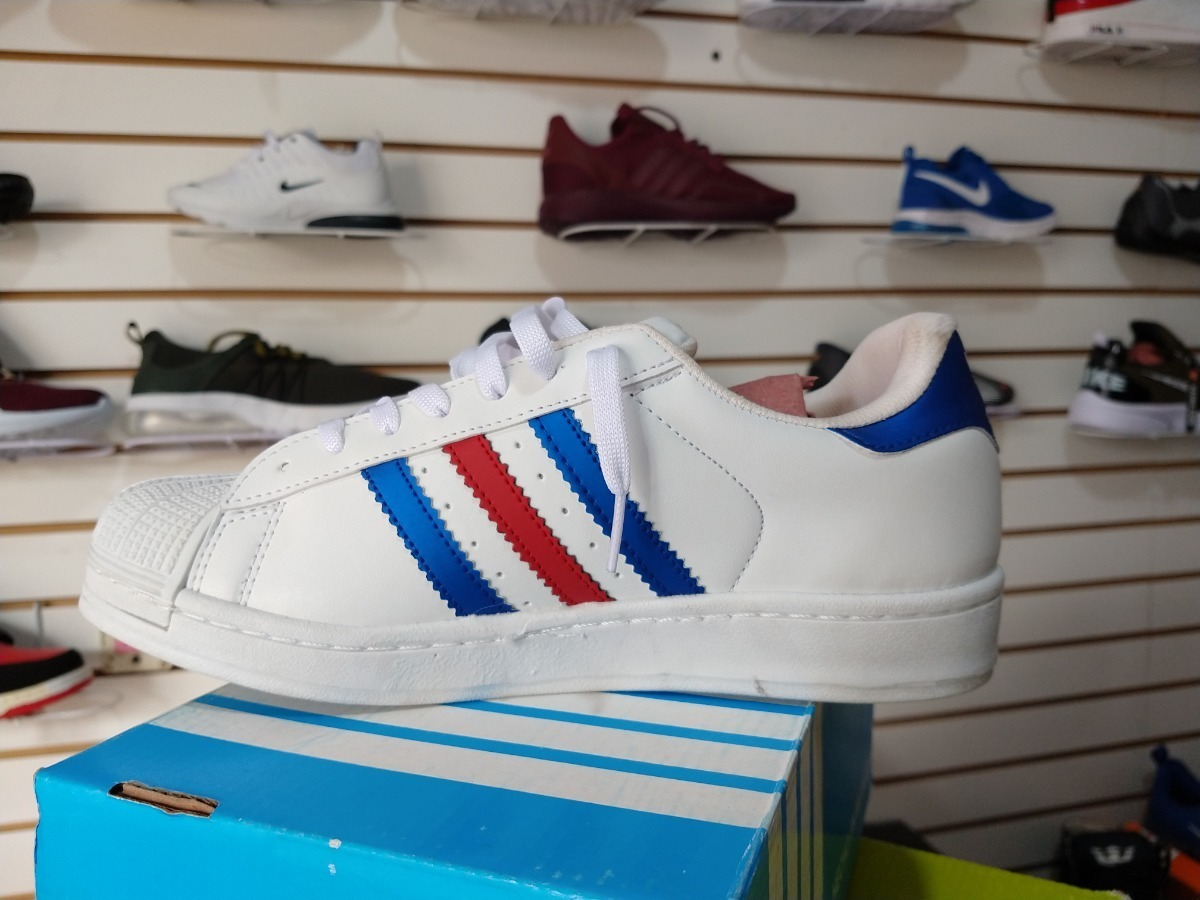 adidas superstar blancas con azul y rojo