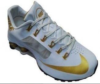 3789a89b4c0 Tenis Masculino Nike Shox Branco Com Dourado Original !!! - R  765 ...