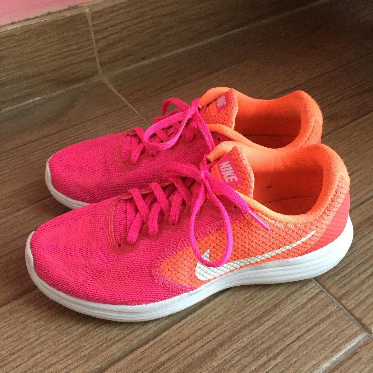 huge discount 62564 92e09 tenis nike revolution 3 neon rosa naranja mujer para correr. Cargando zoom.