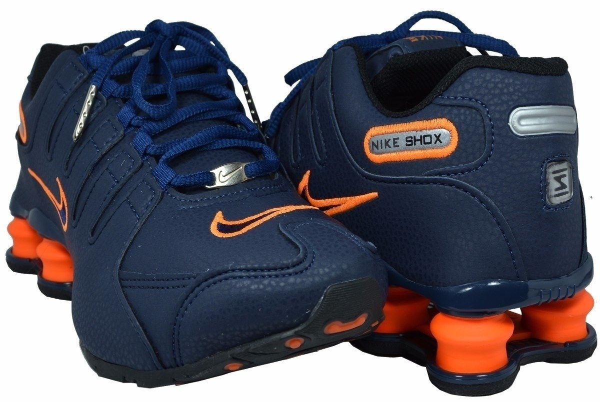 74a4889a6c8 tenis nike shox deliver nz azul escuro e laranja. Carregando zoom.