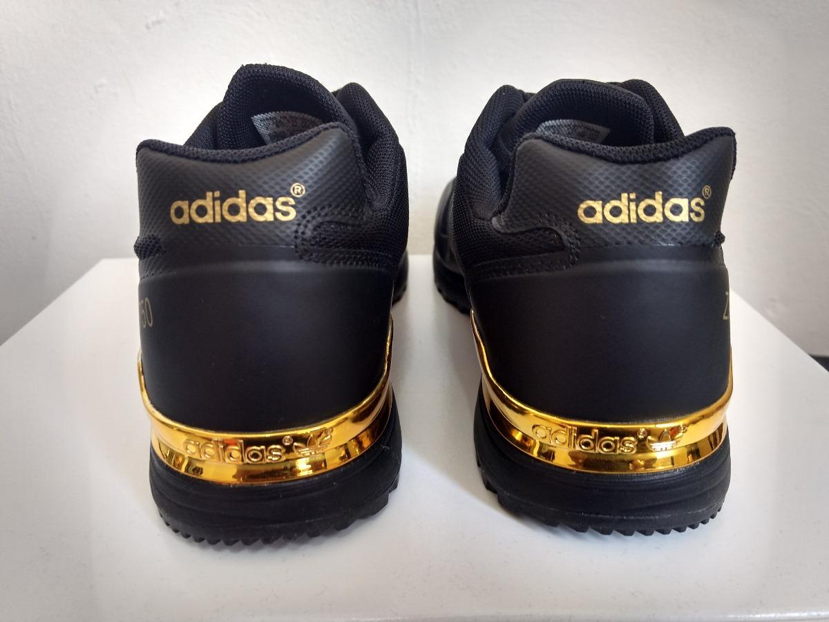 adidas tenis negro con dorado