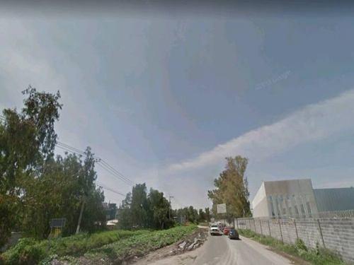 teoloyucan: gran terreno industrial a pie de carretera.