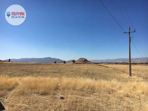 terreno 7.5 hectáreas, a pie de carretera, frente a presa peña del águila