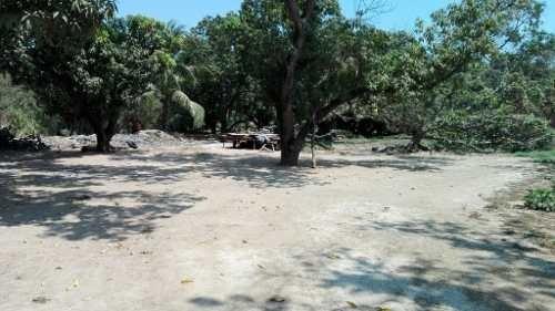 terreno a pie de carretera del macrotunel acapulco  salida cayaco