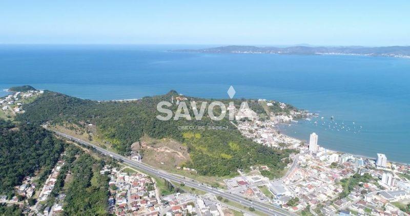 terreno com 6.500 m² de frente para a br 101, trevo das peixarias, itapema, sc - 666