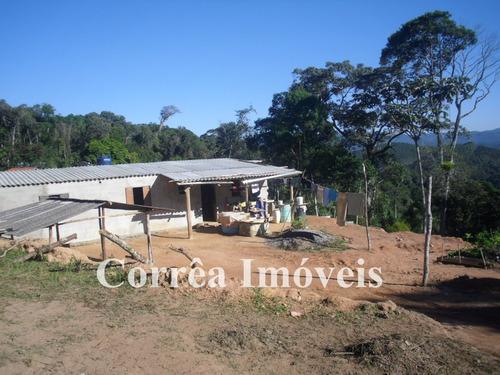 terreno com casa em fase final de acabamento