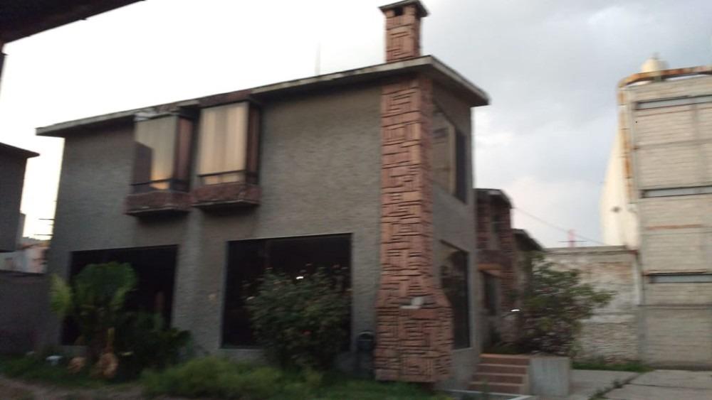 terreno con 2 casas y 1 bodega 1858m²