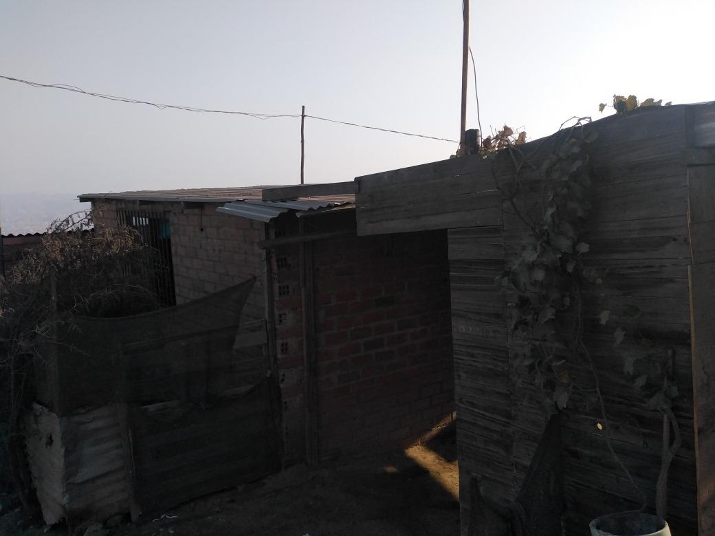 terreno con 2 habitaciones y 1 cocina y baño