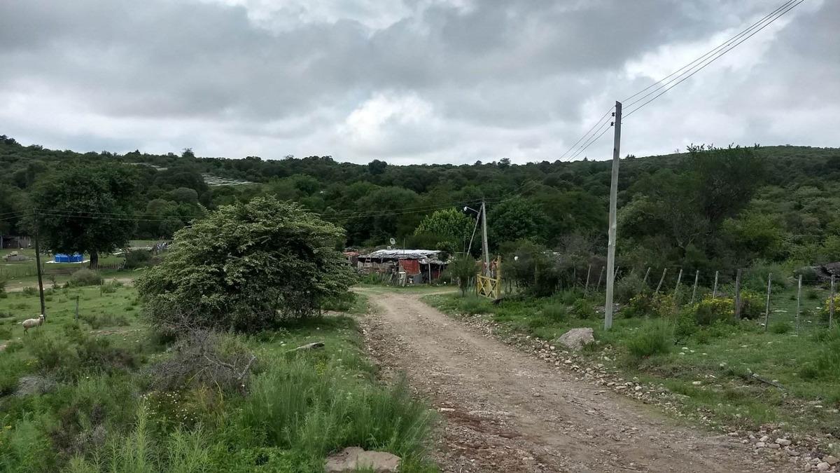 terreno con casa a terminar al lado del rio
