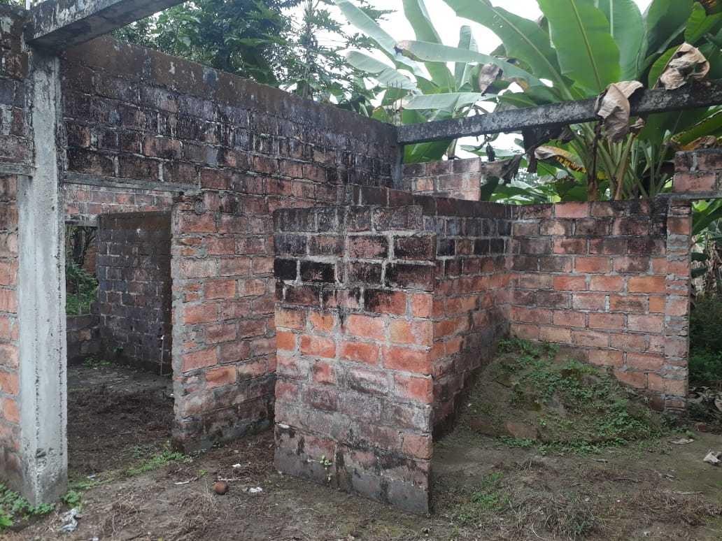 terreno con casa en construcción